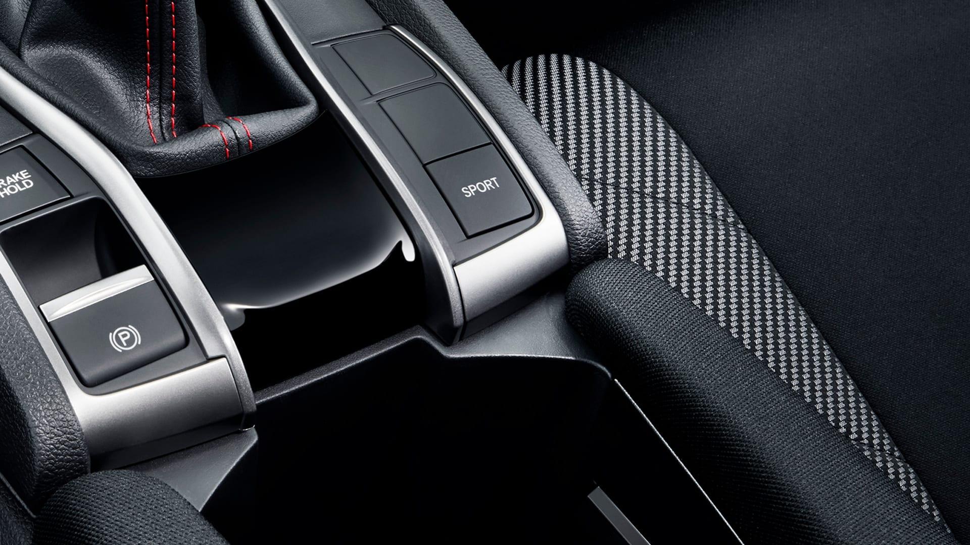 Civic SI - Modo de condução esportivo (tecla Sport) com sistema de amortecimento adaptativo